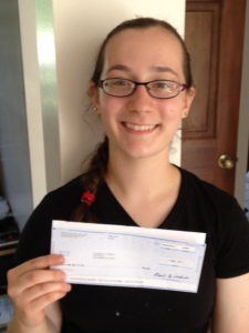 This is an old photo, but here I am with my first paycheck in 2012!